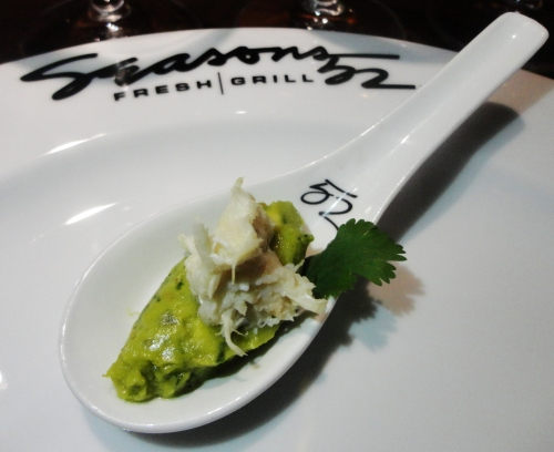 Fresh guacamole with a tantalizing white fish