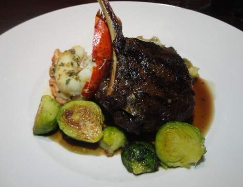 Kona-Crusted Lamb T-Bone Chop with an Oak-Grilled Maine Lobster Tail